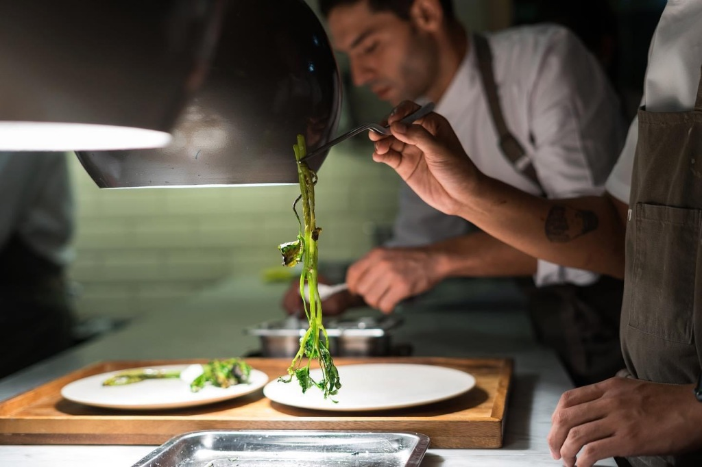 The team at Gallery By Chele plating vegetables